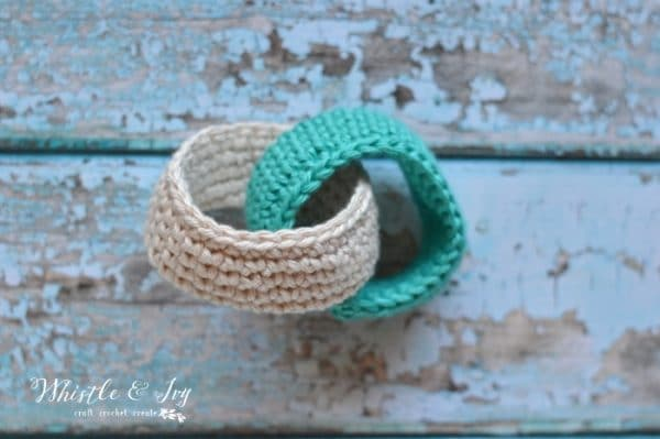 Crochet Baby Teethers - These adorable linked teethers are made with cotton yarn and can be moistened and frozen for extra teething relief.