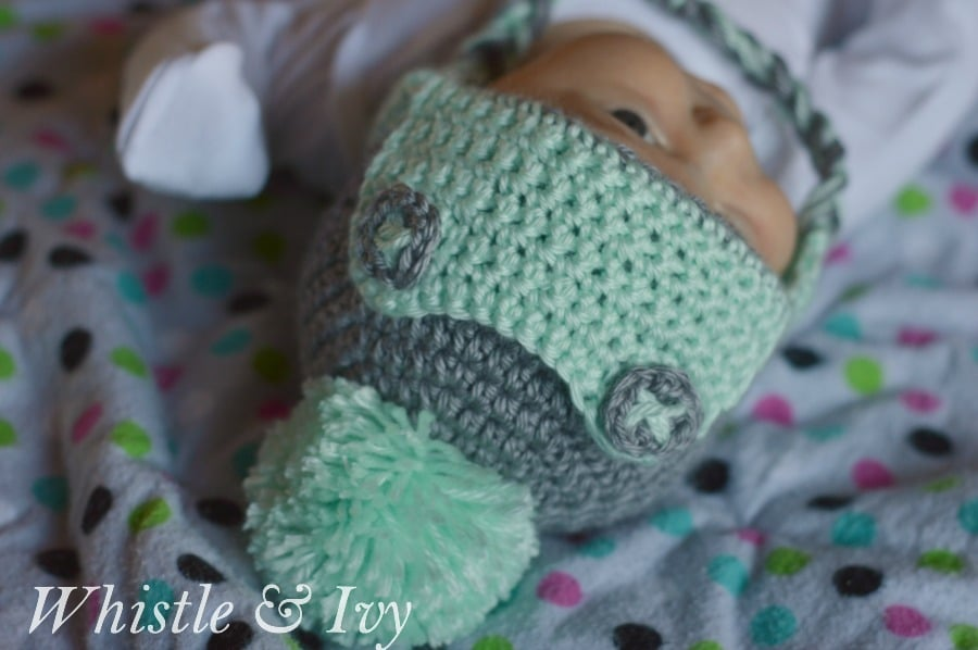 baby wearing cute crochet hat with buttons