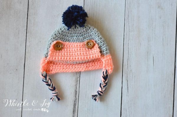 crochet trapper hat pattern with buttons and pom-pom