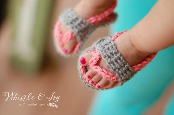 baby wearing pink and gray crochet flip flops