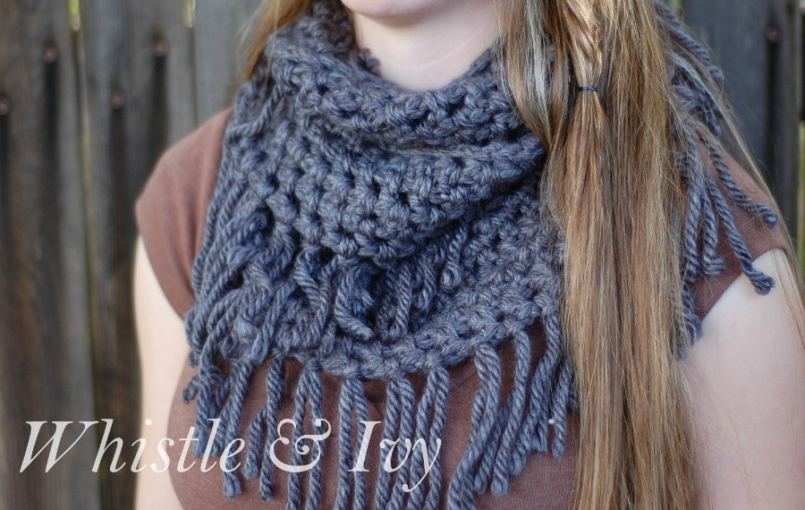 Free Crochet Pattern: Chunky Fringe Infinity Scarf | Make the pretty and cozy infinite scarf with the adorable added yarn fringe!