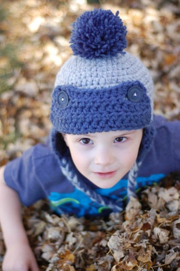 Toddler Trapper Hat FREE Crochet Pattern - Make with two strand, this hat works up quick and is thick and cozy. {Pattern by Whistle and Ivy}