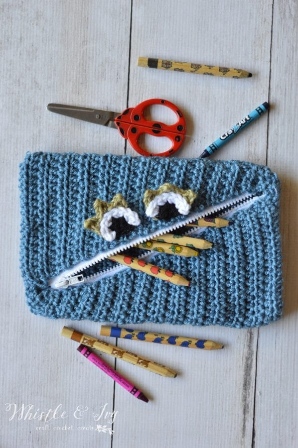 Free Crochet Pattern- Crochet Monster Pouch. Make this fun pouch for carrying pencils and crayons or toys.