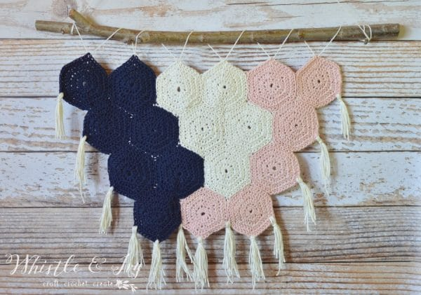 Crochet Hexagon Wall Hanging - Make this cute boho wall hanging with crocheted hexagons. it's a perfect beginner projects, and comes together quickly.