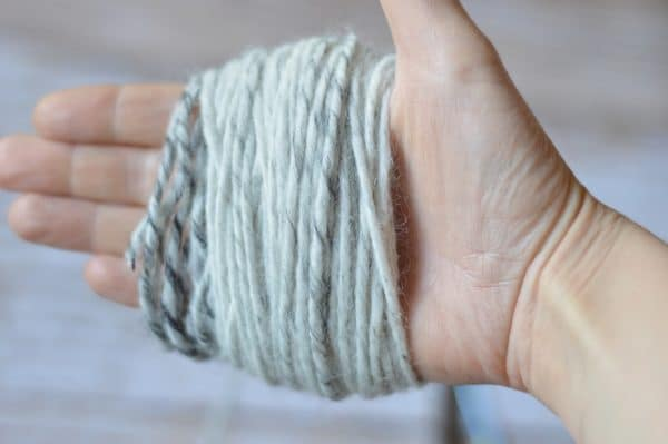 hand wrapped in yarn