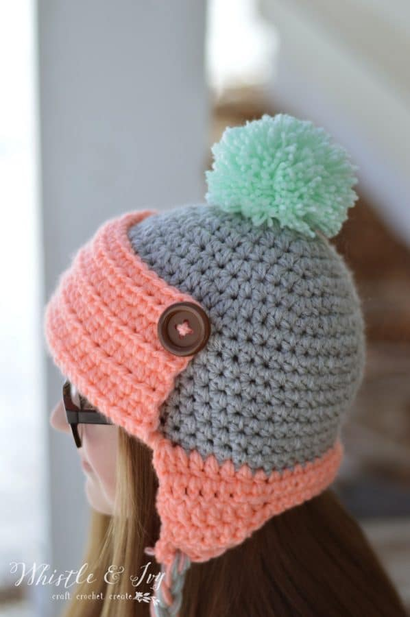 Women's Button Trapper Hat - Crochet this fun and cozy hat this winter with this free crochet pattern.