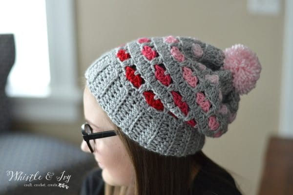 FREE Crochet Pattern: Puppy Love Heart Slouchy | Those adorable crochet hearts are easier to make than you think! Give this slouchy hat a try, it will be your new favorite!