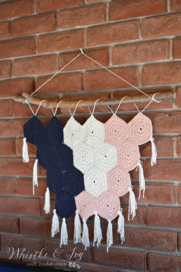 Boho Hexagon Wall Hanging - Make this beautiful wall hanging with some cotton yarn and hexagons. This wall hanging would love lovely anywhere in your home!