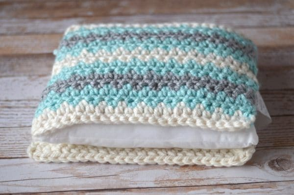 Free Crochet Pattern - Make this beautiful pillow with luscious, chunky yarn! This simple pattern works up quickly. You will love your new, soft pillow!