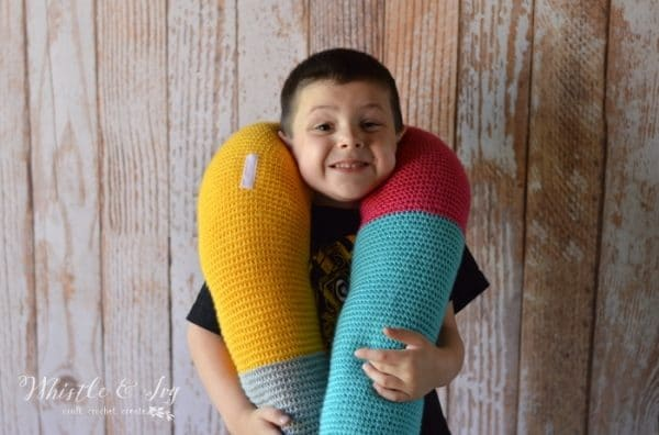 Free Crochet Pattern: Crochet Pretzel Pillow   This fun, pretzel-shaped pillow is fun to make, and fun to use and is multifunctional!