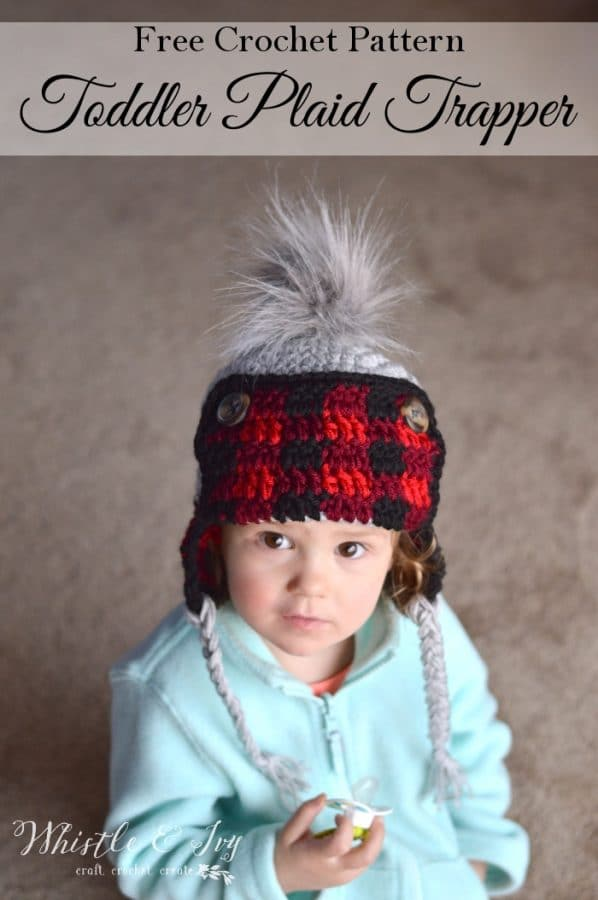 FREE Crochet Pattern: Toddler Plaid Trapper Hat | Keep your toddler toasty warm in this trendy buffalo plaid detail hat! Two strands make it extra cozy.