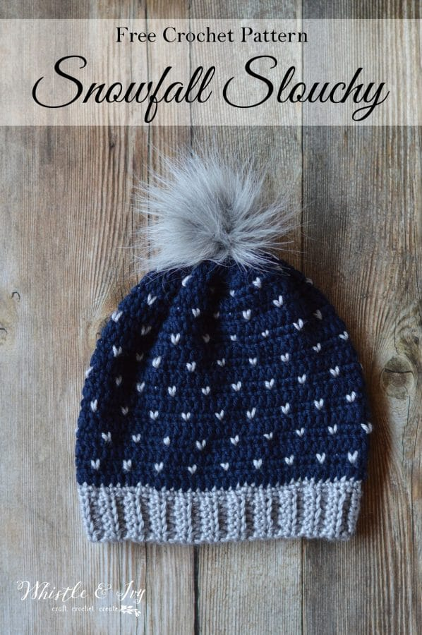crochet navy blue hat with gray hearts knit stitch and gray fur pom-pom