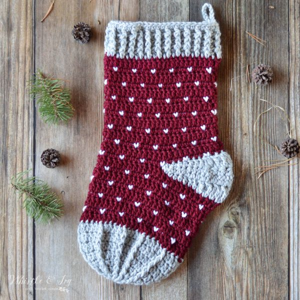 Burgundy stocking with gray toe and heel, features gray hearts knit stitch pattern