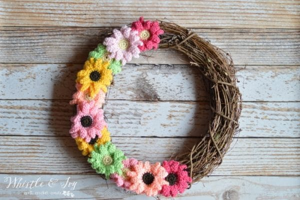 Crochet Gerbera Daisy Wreath - With just a few supplies you can have a new, bright wreath on your front door, featuring pretty crochet Gerbera Daisies.