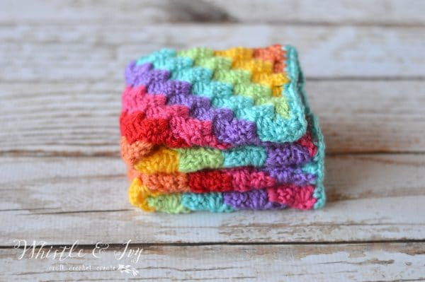 FREE Crochet Pattern: Crochet Rainbow C2c Arm Warmers | Learn how to work the fabulous C2C crochet technique and make these bright and fun arm warmers.