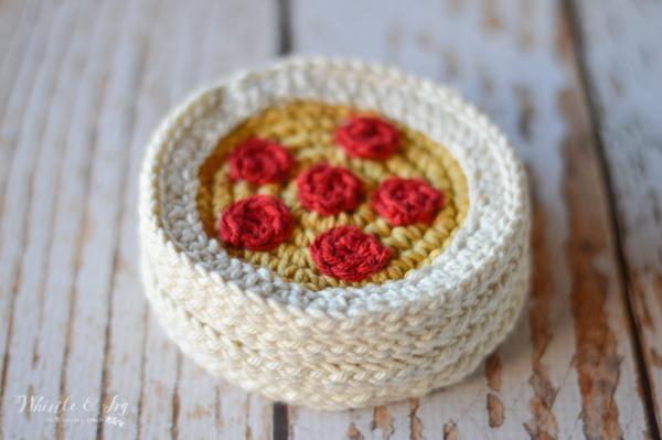 crochet pizza coaster on wood