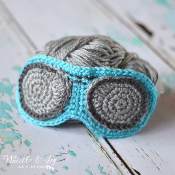 blue crochet aviator sleep mask with yarn