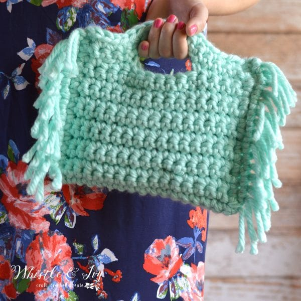 FREE Crochet Pattern: Anthropologie-Inspired Fringe Clutch | A quick, chunky project. Perfect for beginners with a stylish result!