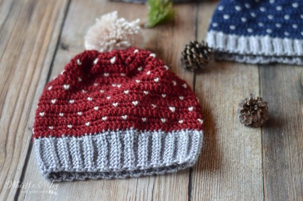 Burgundy crochet hat with yarn pom-pom with heart shaped knit stitch  pattern. 6cb9f56c5a0