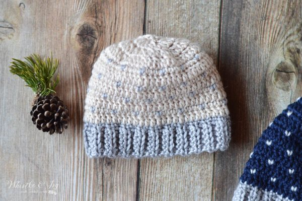 Cream colored crochet hat with heart shaped knit stitch pattern.