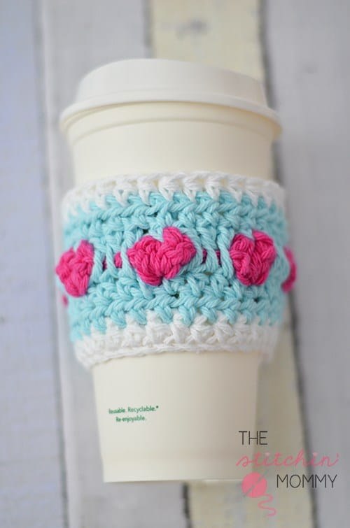 Crochet Blue coffee cup cozy with pink hearts