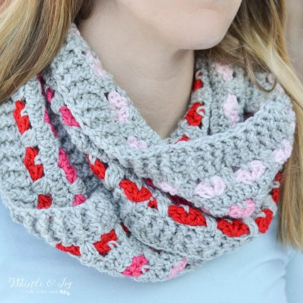 gray crochet infinity scarf with little pink and red hearts