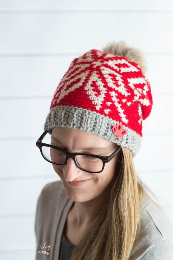 woman wearing red and white fair isle team canada toque hat for olympics