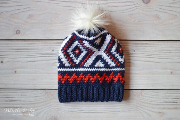 olympic team crochet hat with red white and blue color work with white fur pom-pom