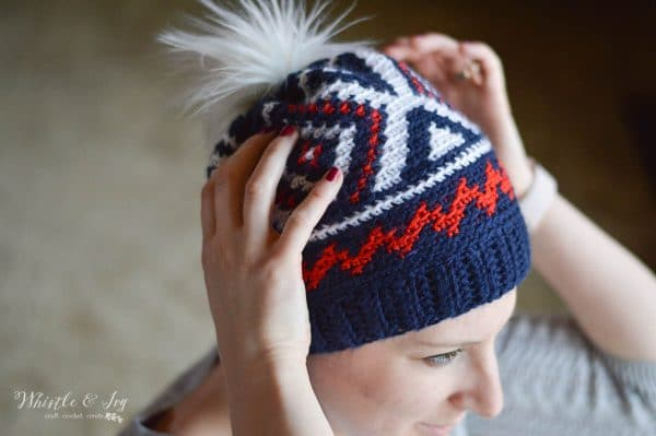 woman wearing olympic team crochet hat with red white and blue color work