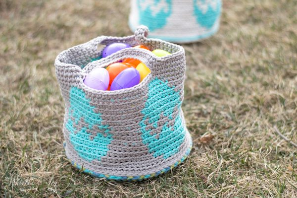gray crochet Easter egg basket sitting on the grass