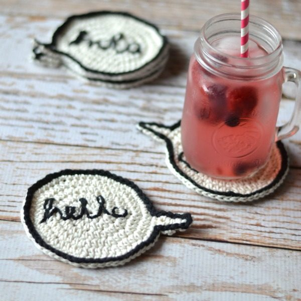 crochet coasters that look like speech bubble and a mason jar mug with fruity drink