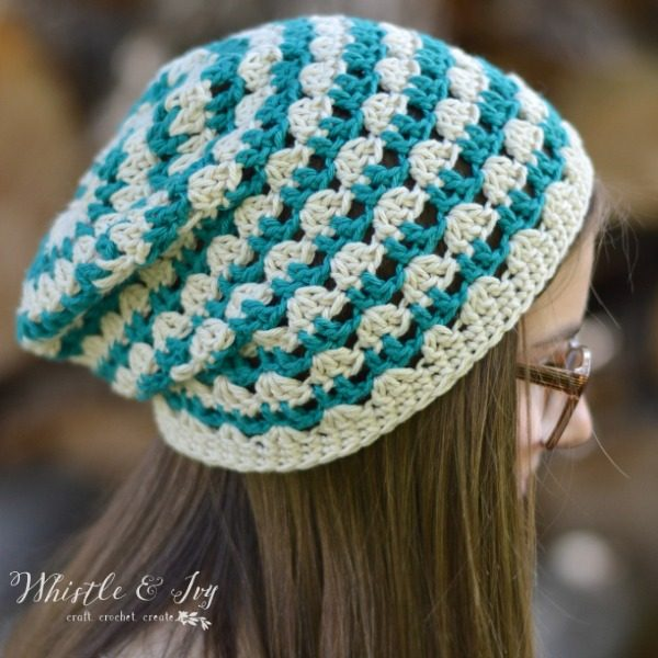 girl wearing a light cotton crochet hat