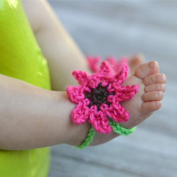 baby foot wearing a crochet flower barefoot sandal