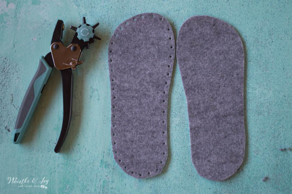 felt slipper soles with holes punched around the outside