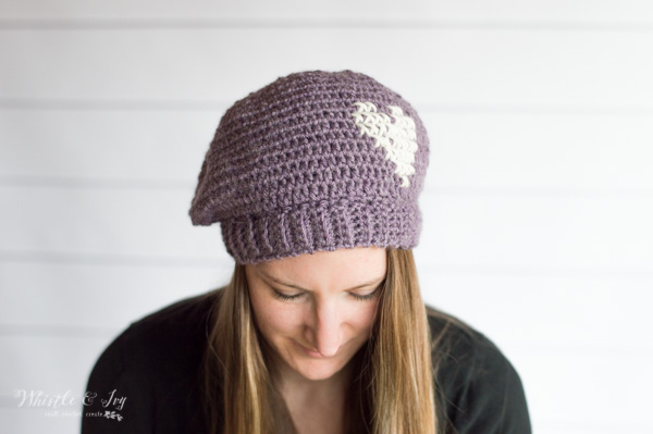 woman wearing a crochet beret, part of a monthly crochet subscription, happy yarn mail