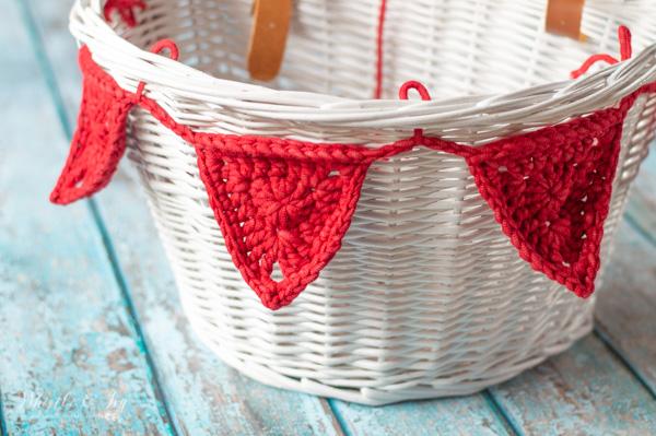crochet bike bunting on basket made with outdoor yarn
