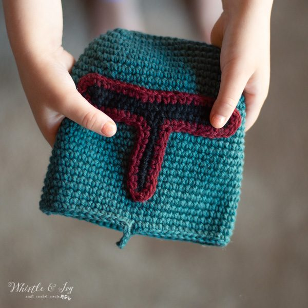 child holding boba fett crochet pouch