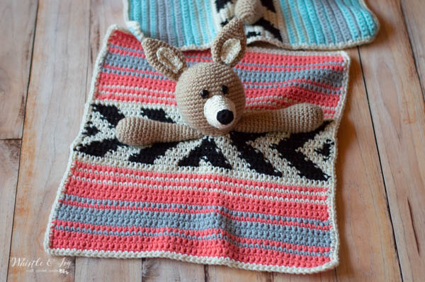 pink crochet serape lovey with cute coyote