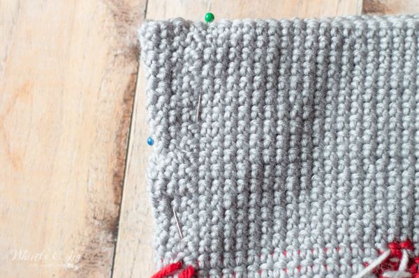 sewing sides of crochet mushroom pouch