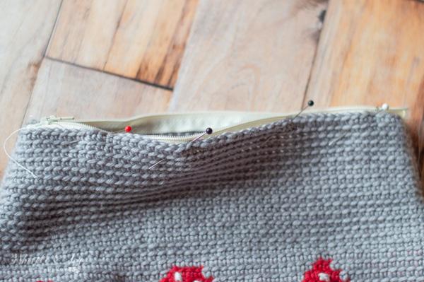 sewing zipper into crochet mushroom pouch