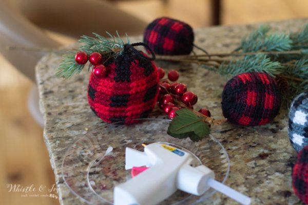 putting embellishments on crochet plaid ornaments
