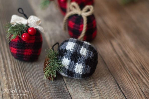 crochet plaid ornaments with evergreen and pinecone