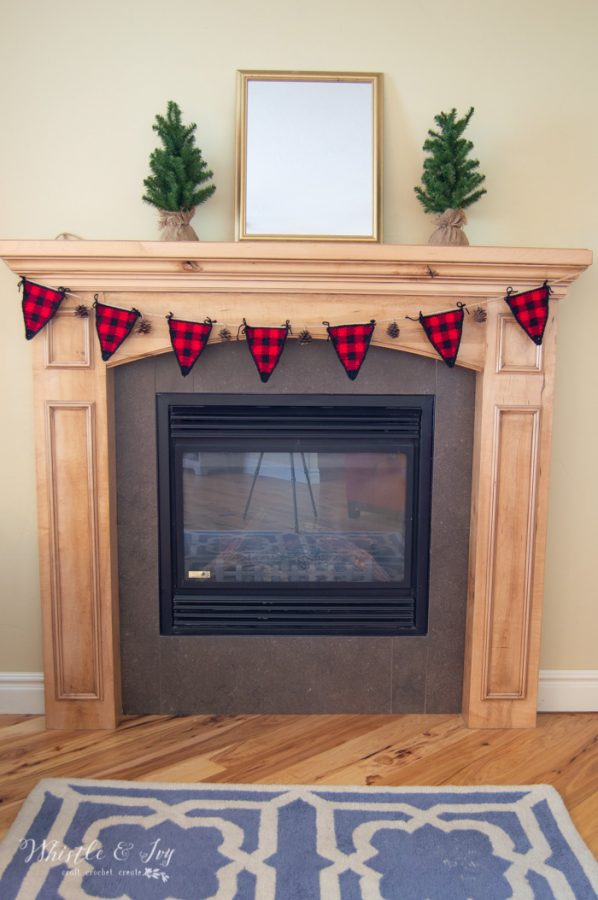fireplace with buffalo plaid garland with free crochet pattern