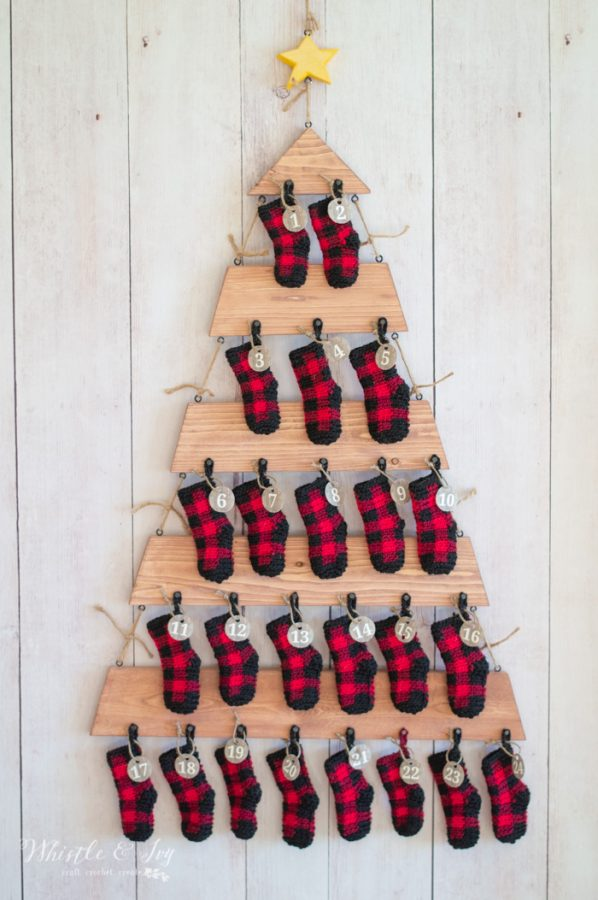 crochet plaid stockings on wood tree advent calendar