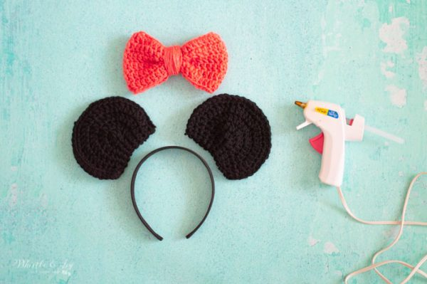 glueing together Minnie Mouse ears free crochet pattern