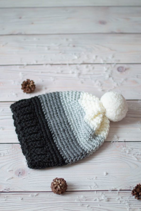 crochet hat with plush sherpa pom-pom