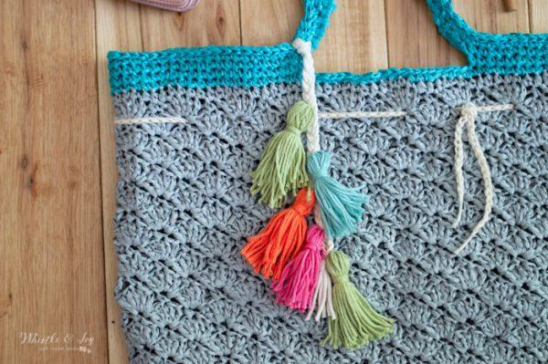 colorful yarn tassels on crochet shells beach tote free pattern