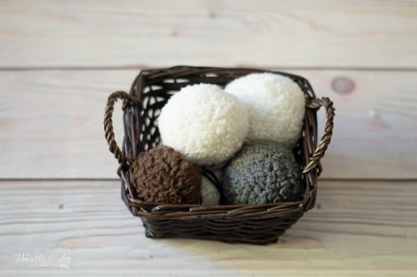 a basket full of sheepskin pom-poms